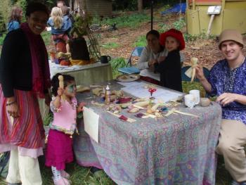 Cornucopia 2007: kids making corn husk dolls