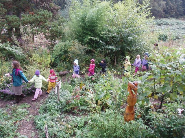 Mother Earth Kindergarten walking through garden